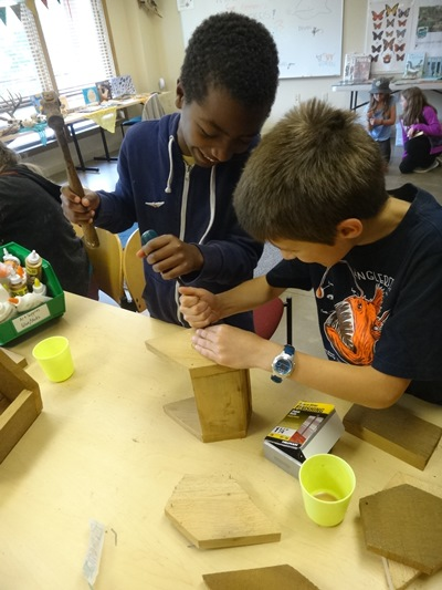 two boys crafting during camp
