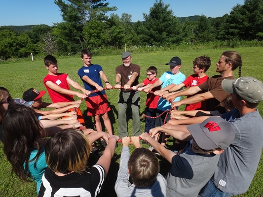 Campers in a circle engaged in team building