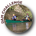 Two fellas in a canoe participating in the Dam Challenge