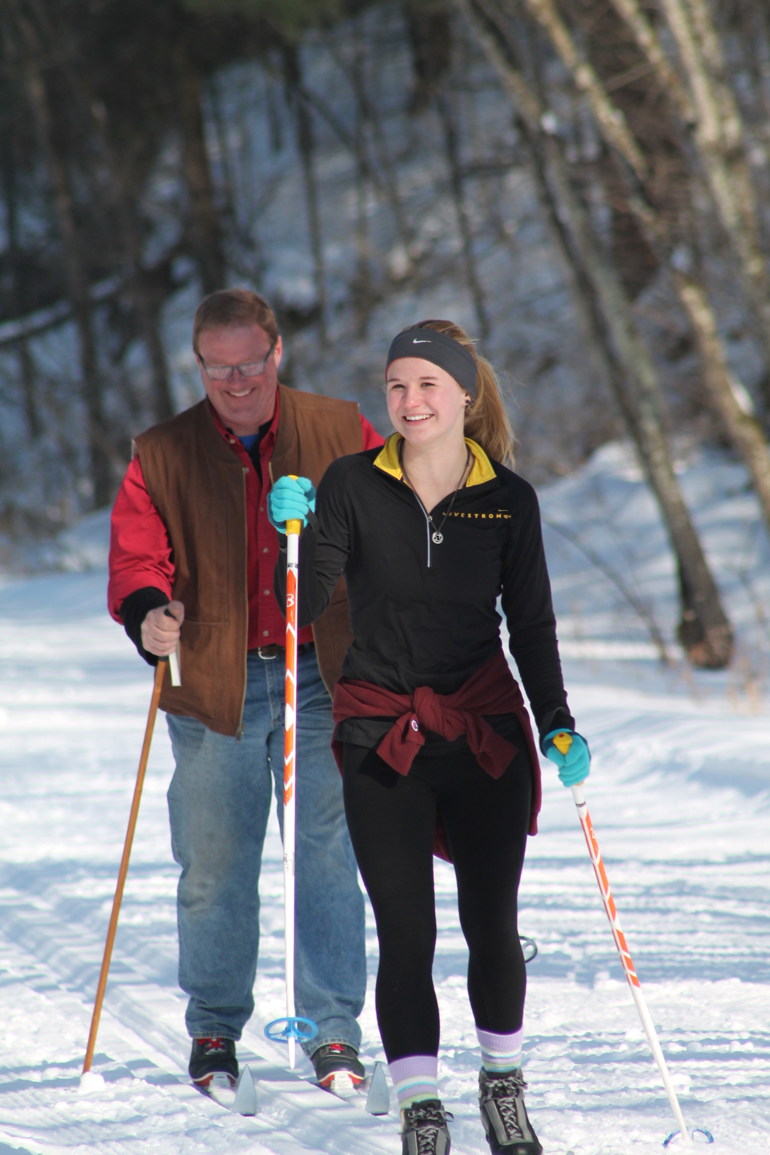 Woman and Man Cross Country Skiing